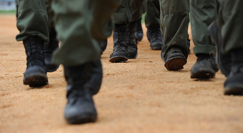Congolese soldiers assigned to the Congolese Light Infantry Battalion march at double-time to their next training site at Camp Base in Kisangani, Congo, May 5, 2010 Jocelyn A. Guthrie